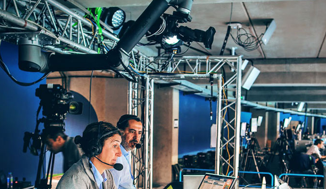 Image Featuring Usage Of Collaborative Robot In Television Industry - Professional Camera people With Headphones With HD Camcorder In Live Television.